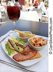 Hot Tapas - Hot tapas consisting of fried sardines, bacon on...