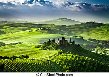 Beautiful sunrise in the valley of San Quirico d'Orcia,...