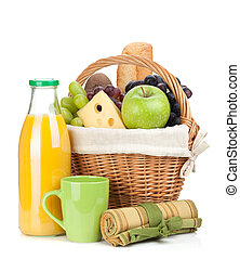 Picnic basket with bread, fruits and orange juice bottle...