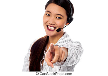 Call centre support staff pointing towards camera - Female...