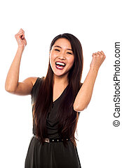 Excited woman with clenched fists - Woman clenching her...
