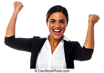 Excited woman with clenched fists - Businesswoman clenching...