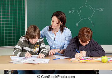 Elementary students - Portrait of teacher with elementary...