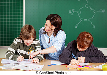 Teaching students - Portrait of a smiling teacher with...