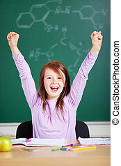 Jubilant little girl in school - Jubilant excited little...