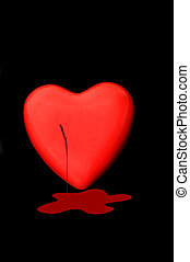 Bleeding heart - Bleeding Red heart isolated on a dark back...