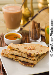 chapati Paratha Fold with traditional indian items...