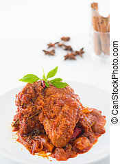 curry rendang chicken, indian cuisine with traditional food items on background
