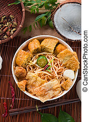asam laksa noodle ,Penang style with raw ingredients on background