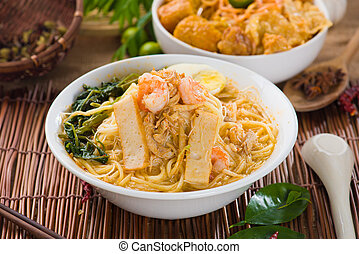 malaysian famous prawn noodle or har mee with decorations on...