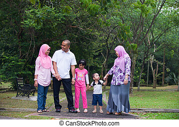 Malay family enjoying quality time outdoor at the park