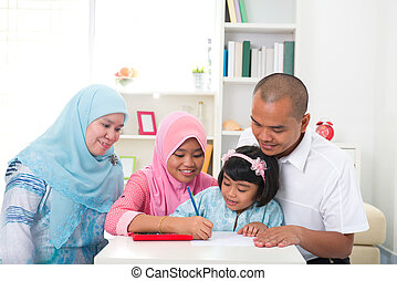 malay family learning together with lifestyle background -...