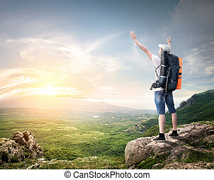 Tourist with backpack enjoy valley view from top of a...