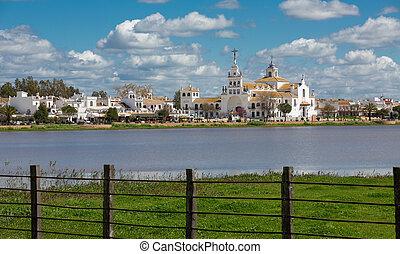 El Rocio - View of El Rocio and wooden fence, Andalucia,...