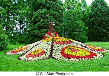 Flower peacock sculpture on Mainau island, Germany - flower...