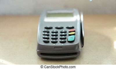 Credit card terminal - Female hand swiping a credit card...