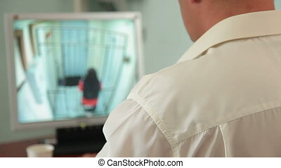 Security guard in control room at CCTV