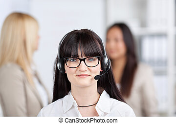 Customer Service Representative Wearing Headset In Office