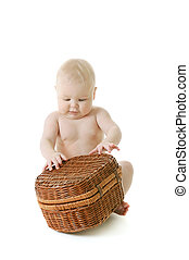 Baby with basket - little baby playing with basket on white...