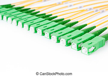 green fiber optic SC connectors on white background