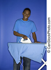 Teen boy doing chores - Portrait of African-American teen...