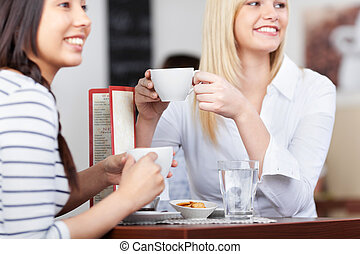 young people in cafe relaxing with a cup of coffee - young...