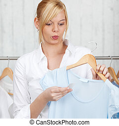 Shocked Woman Looking At Price Tag On New Top - Shocked...