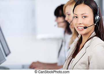 costumer service executives with headset - three costumer...