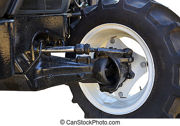 transmission of a tractor - detail of the front wheel...
