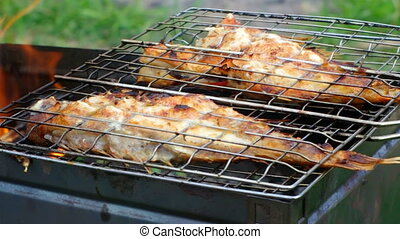 barbecue Rock Fish on the grill with flames grilling sea...