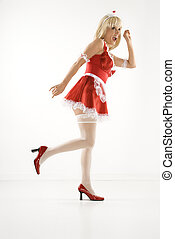 Woman in maid outfit. - Blonde Caucasian young woman in...