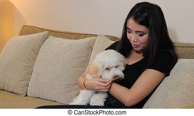 Asian Woman Gives Dog A Treat - A pretty Asian lady gives...