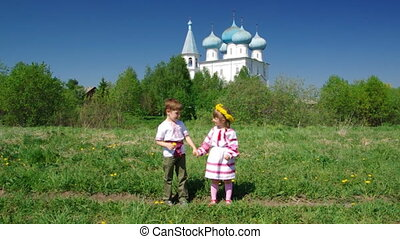 Russian Little boy and girl on a orthodox church background...