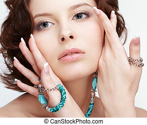 woman with teal beads - portrait of beautiful brunette young...