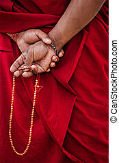 Tibetan Buddhism - prayer beads in Buddhist monk hands...