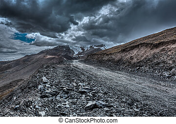 Road in Himalayas with mountains - Road in Himalayas near...