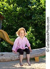 Kindergarten child at an outdoor playground - Cute little...