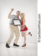 Man receiving certificate. - Young Caucasian man cheering...