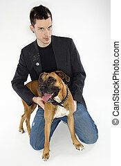 Man with Boxer dog. - Young adult Caucasian male with Boxer...