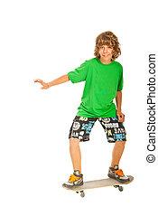 Happy teen boy skateboarding