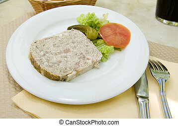 French food pate terrine of rabbit in cafe photographed in...
