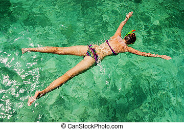 young girl on the beach snorkel Maya Bay on Phi Phi Ley,...