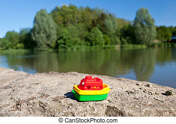 Little colourful plastic boat at the lake - Little colourful...