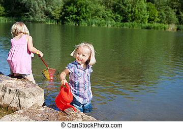 Little girls having fun at the lake