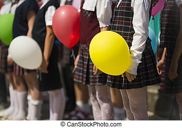 school children with balloons