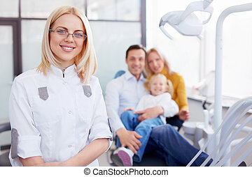 Stomatology - Family in the dentists office