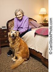 Mature woman with dog. - Elderly Caucasian woman and dog in...