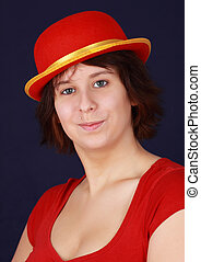 girl with red hat - closeup portrait of young woman with red...