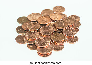US pennies piled up over white background