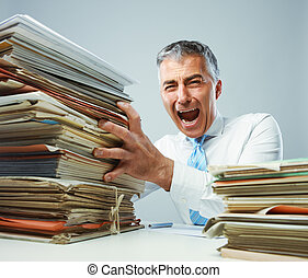Overworked mature business man screaming in anger